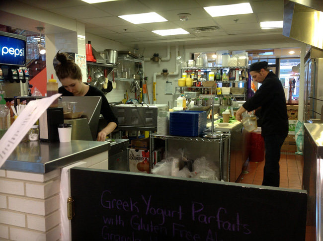 Firefly Fare Open Kitchen with Owner and Chef hard at work.
