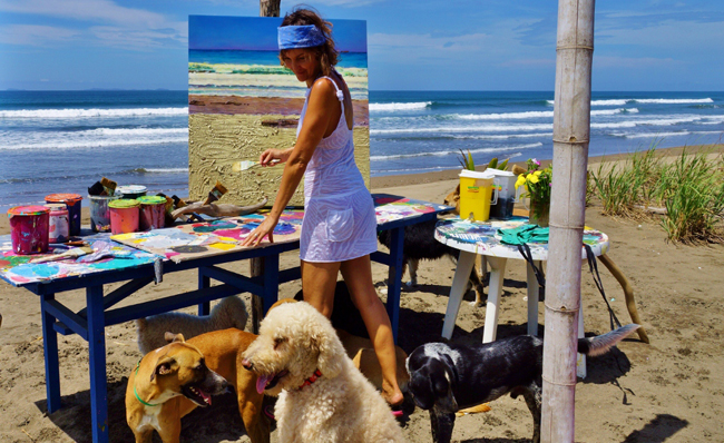 Chantal Painting On Beach With Dogs