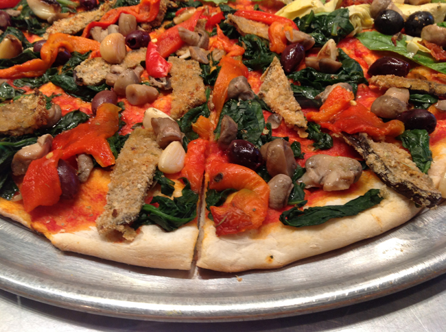 Christian's eggplant pizza with spinach, garlic, mushrooms, roasted red peppers and kalamata olives