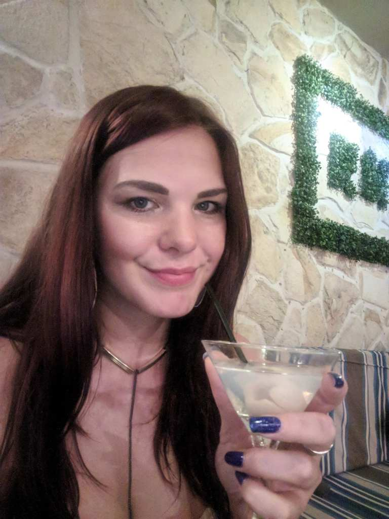 Me drinking a Lychee Martini at a cocktail bar in Bali, Indonesia