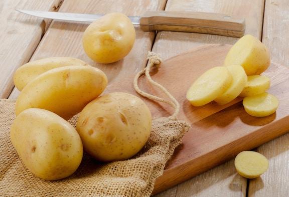Potatoes on cutting board