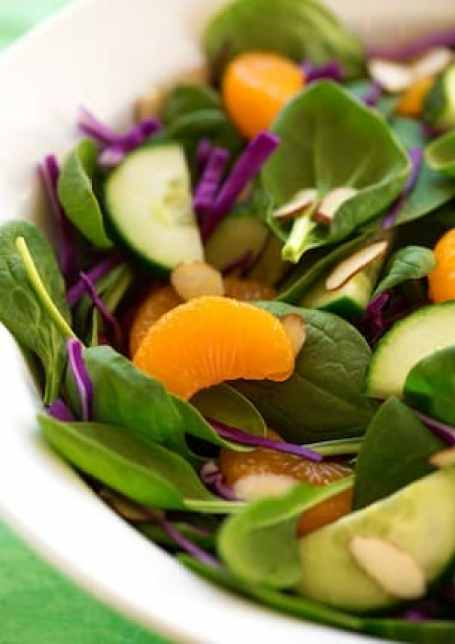 Spinach, orange, and red cabbagea salad
