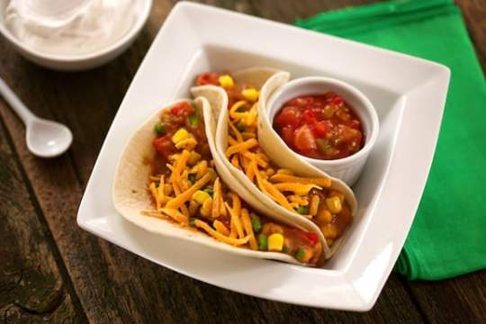 Vegan soft tacos with refried beans and corn