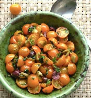 Golden tomatoes with garlic and parsley