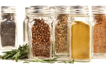 Spice jars with various spices