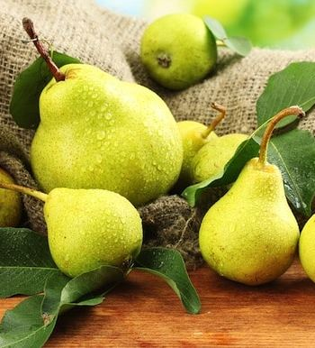 Juicy pears on table