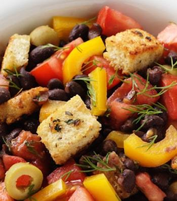 black bean salad with tomatoes, croutons, and olives