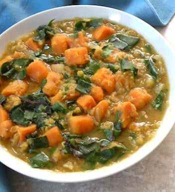 Red lentil soup with sweet potatoes and greens