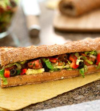 Mediterranean salad-stuffed bread (pan bagnat)