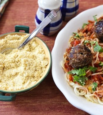 Vegan meatballs on pasta with vegan parmesan cheese