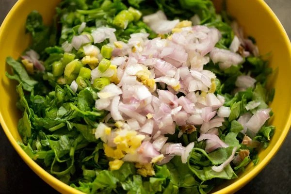 chopped onions, ginger and green chillies added to spinach