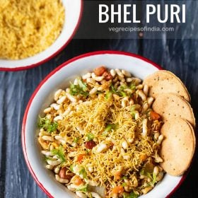bhel puri served with a side of crisp baked puri in a red rimmed white bowl