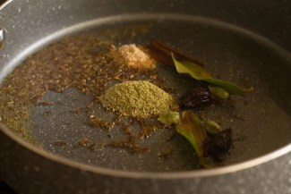 ginger and fennel powders added to spiced ghee for pulao