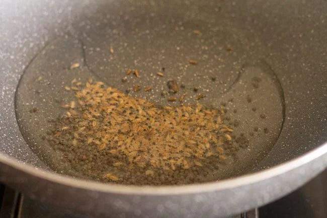adding cumin seeds