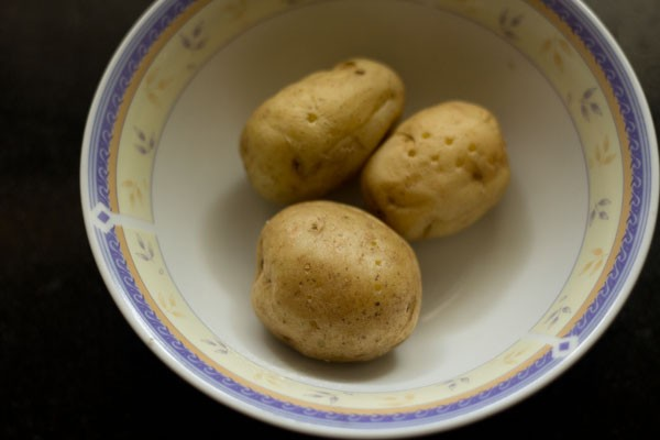 three potatoes in a bowl