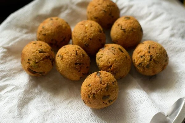 completed fried cheese balls draining on a paper towel