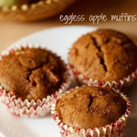 eggless apple muffins served on a white plate