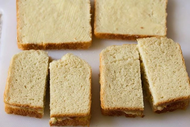 Top with the remaining buttered slice of bread