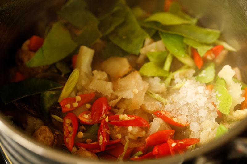 kaffir limes, thai red chiles, galangal and lemongrass added to vegetable mix