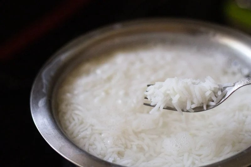 rice grains cooked al dente shown in a fork