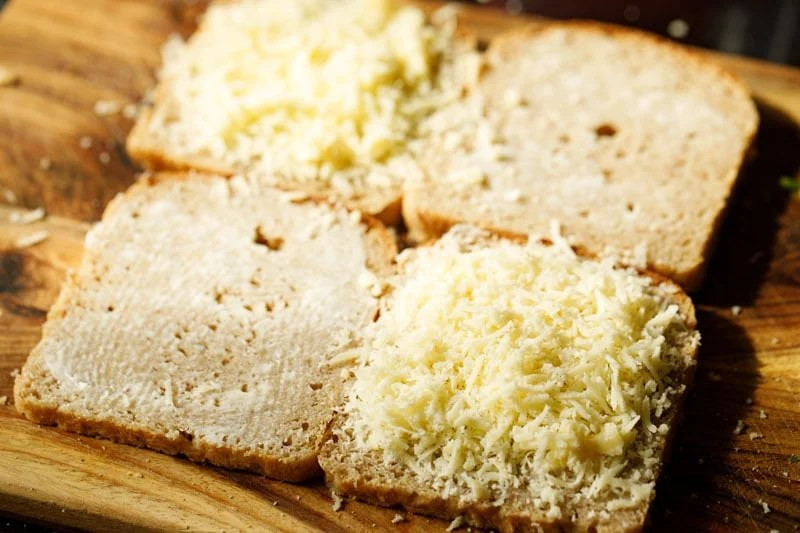 bread slices topped with grated mozzarella cheese