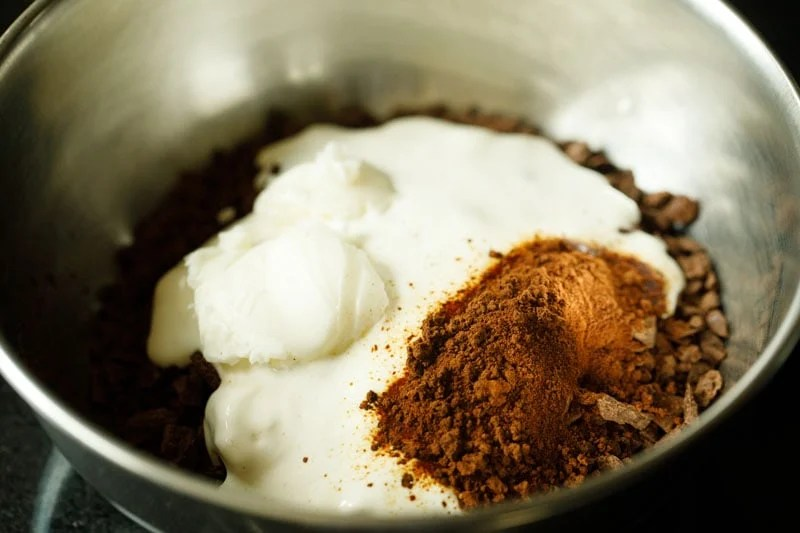 cream, instant coffee, butter and pinch of salt in the bowl with chocolate