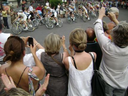 In a flash, the peloton shoots past.