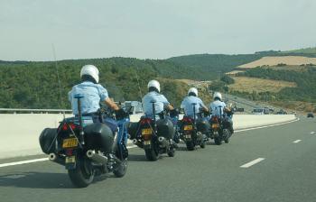 The cops team pursuit past us at speed.