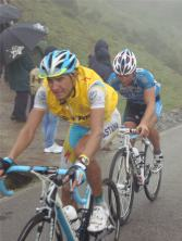 Astana riders in their yellow gilets.