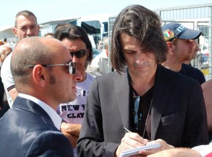 Paolo Bettini and L'Equipe's Philippe Brunel.