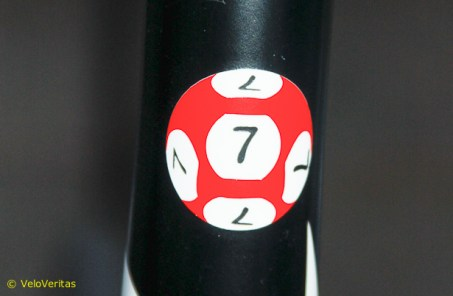 Up at the Lotto bus, we discovered how Lars Bak won the other day - it's that lucky 7 on his seat post.