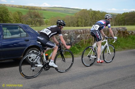 Lap 7: Arthur Doyle and Dale McCallum in the bunch.