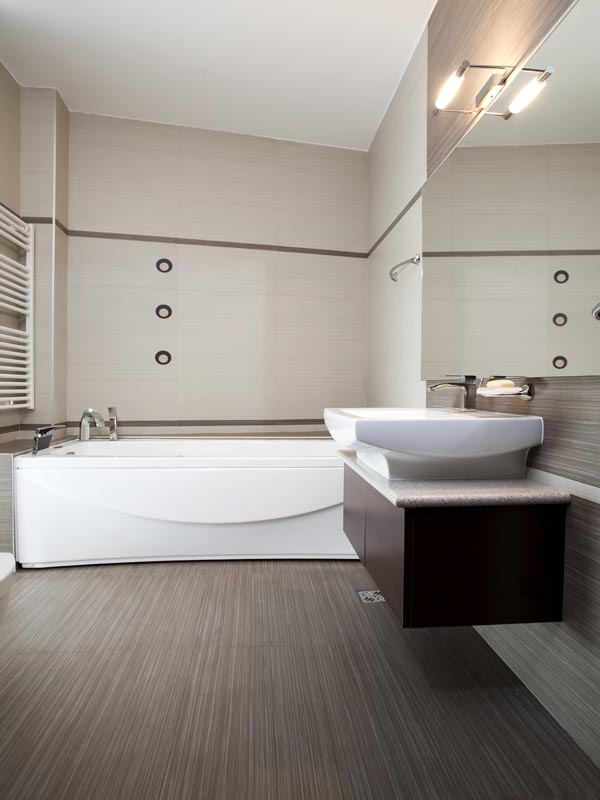combination of cream, brown and light grey tiles with a strip