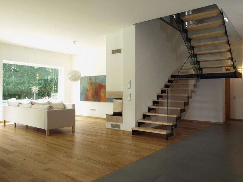 combination of grey tile and wood en flooring