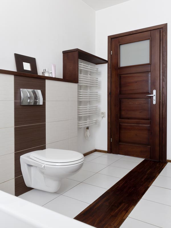 combination of polished white tile and wood look alike for bathroom floor