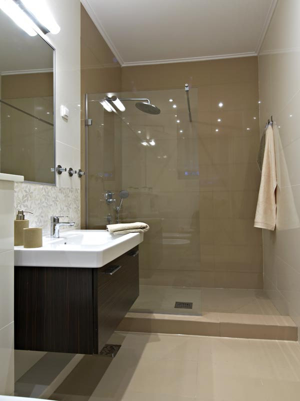ivory white tiles on the bathroom floor and walls