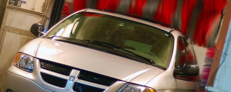 Image showing VEMA light duty vehicle van going through a car wash