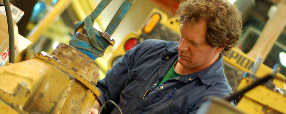 Image showing VEMA qualified repair technician operating repair machinery