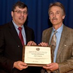 Goddard Center Director Christopher Scolese (left) presents Thomas Macdonald, VP Aerospace of Adcole Corporation with the Goddard Space Flight Center Small Business Subcontractor of the Year Award for 2015