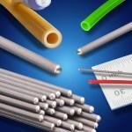 Closeup of straight catheter on sterile field.