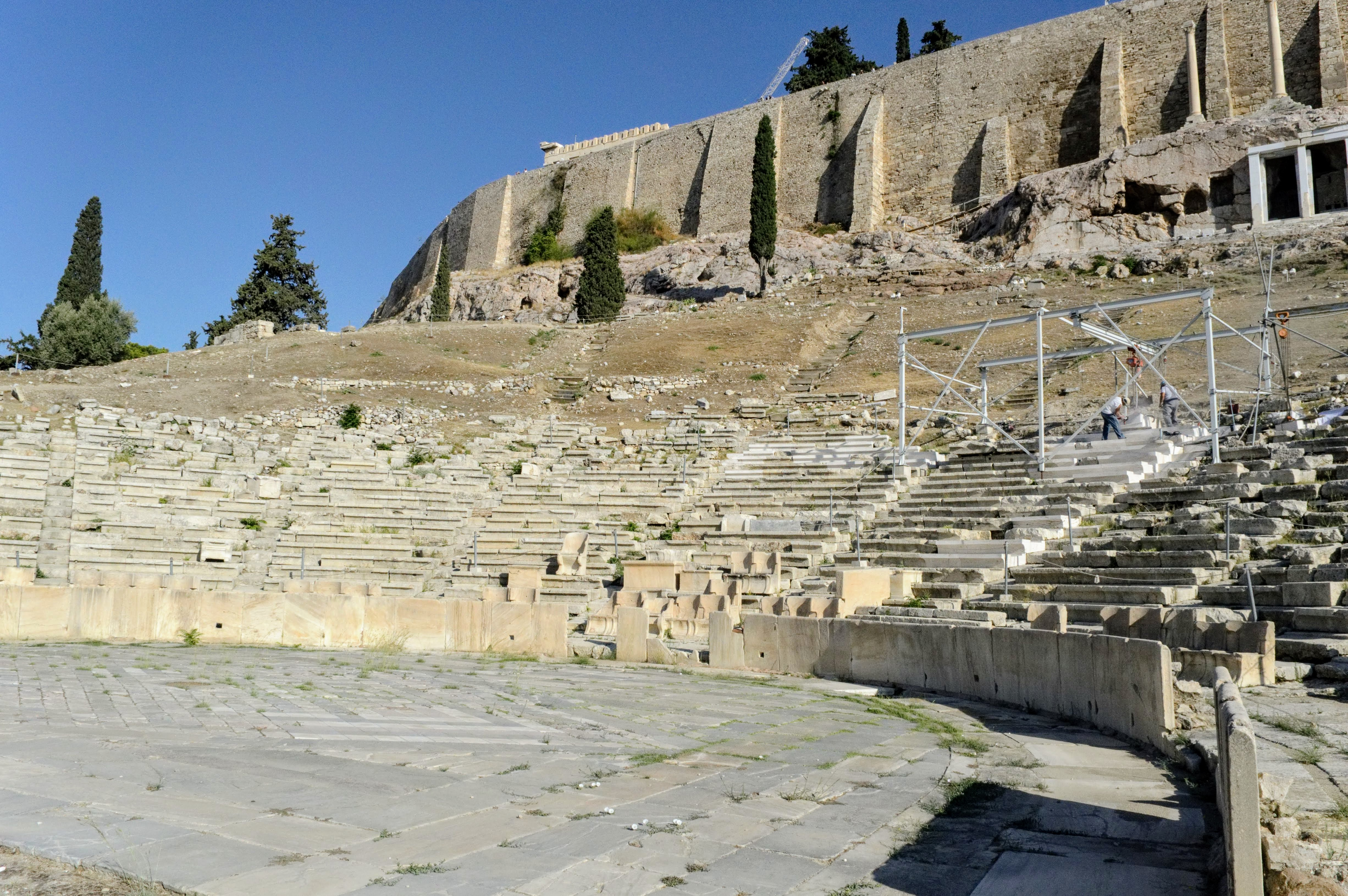 Theatre of Dionysus - Athens, Greece, Europe - Honeymoon Part 1 - Athens is a beautiful capital city rich with history. With it's impressive Acropolis and quaint pedestrian streets, we headed here for our Honeymoon Part 1! Veritru Travel Blog