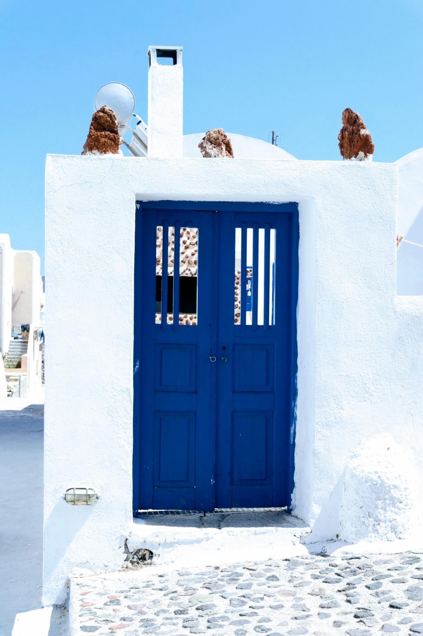 Oia blue doors - Honeymoon Part 2 - Oia in Santorini Greece is beautiful with its pretty caldera view, sunsets, windmills and quaint pedestrian streets, we headed here for our Honeymoon Part 2! - Greek Island, Europe - Veritru