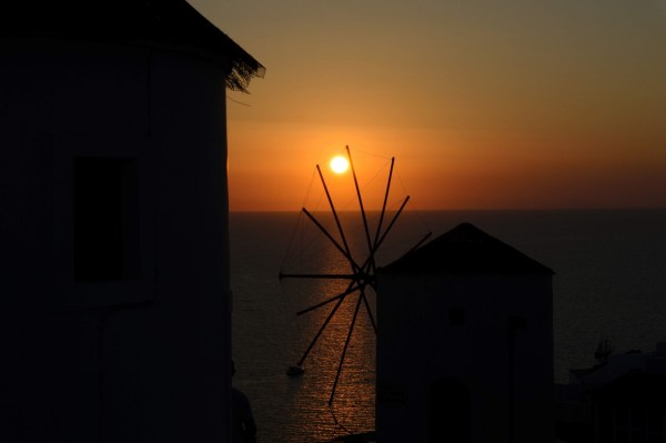 7 Things No One Tells You About Santorini - Elinikon Restaurant View Famous Oia Windmill during the sunset - Honeymoon Part 2 - Oia in Santorini Greece is beautiful with its pretty caldera view, sunsets, windmills and quaint pedestrian streets, we headed here for our Honeymoon Part 2! - Greek Island, Europe - Veritru
