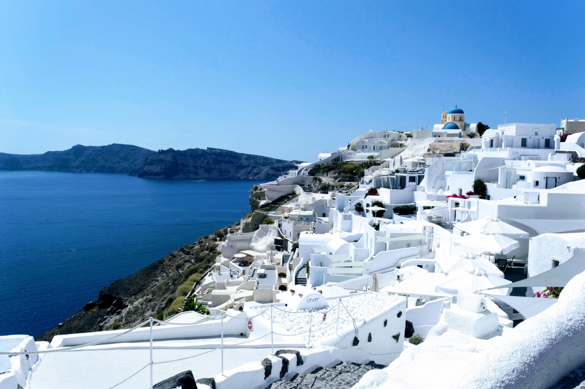 Famous Oia Blue and white buildings - Honeymoon Part 2 - Oia in Santorini Greece is beautiful with its pretty caldera view, sunsets, windmills and quaint pedestrian streets, we headed here for our Honeymoon Part 2! - Greek Island, Europe - Veritru