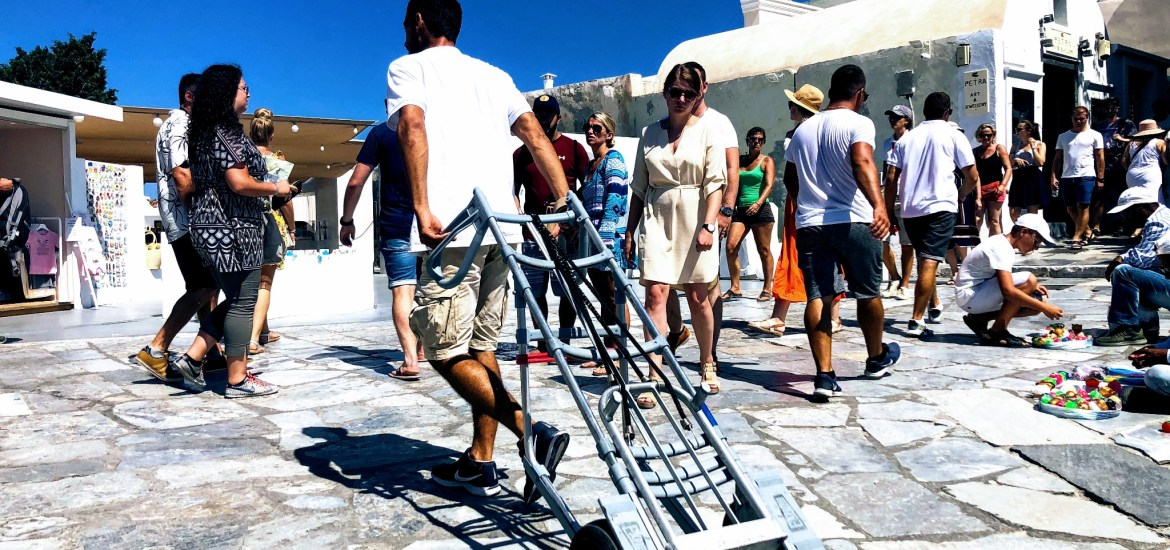 Oia luggage porters - Honeymoon Part 2 - Oia in Santorini Greece is beautiful with its pretty caldera view, sunsets, windmills and quaint pedestrian streets, we headed here for our Honeymoon Part 2! - Greek Island, Europe - Veritru