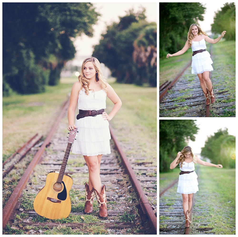 Senior portraits on railroad tracks near downtown St Petersburg by Vernon Photography, Inc