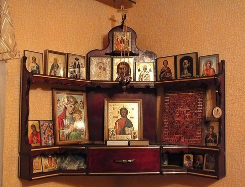 About this Corner, image of an altar with catholic blessed icons.