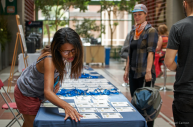 Volunteer giving out name badges at the registration table at WordCamp Montreal 2015