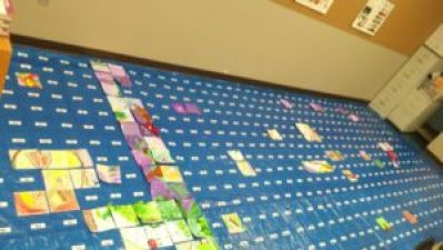 Student tiles are starting to fill up the actual sized layout for the Otto Petersen Mural!