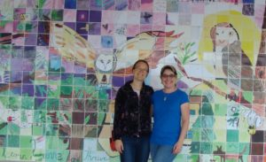 Artists Jennifer Hanson and Veronica Reeves in front of the Otto Petersen Elementary Mural to be unveiled June 21st, 2017